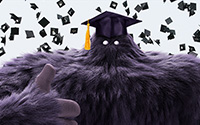 Monster mascot with a gradution hat giving a thumbsup.