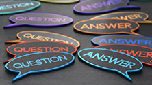 Multicolored cartoon bubbles with the words Question and Answer in them.