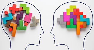 Two heads filled with colored blocks